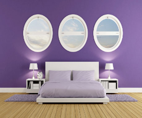 purple-bedroom-with-oval-windows