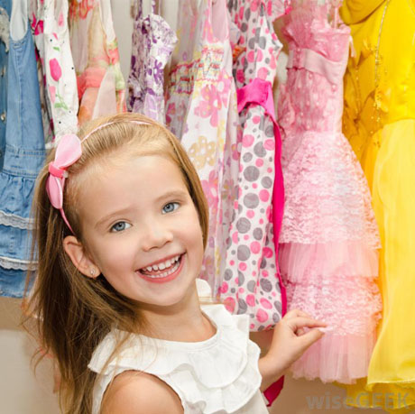 young-girl-at-closet-with-dresses